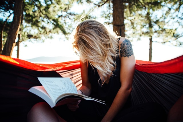 woman reading in hammock